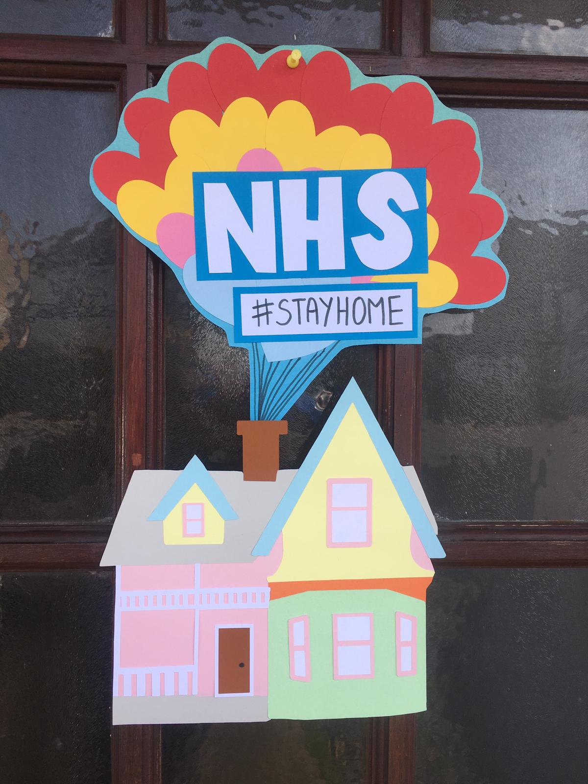 NHS stay home sign