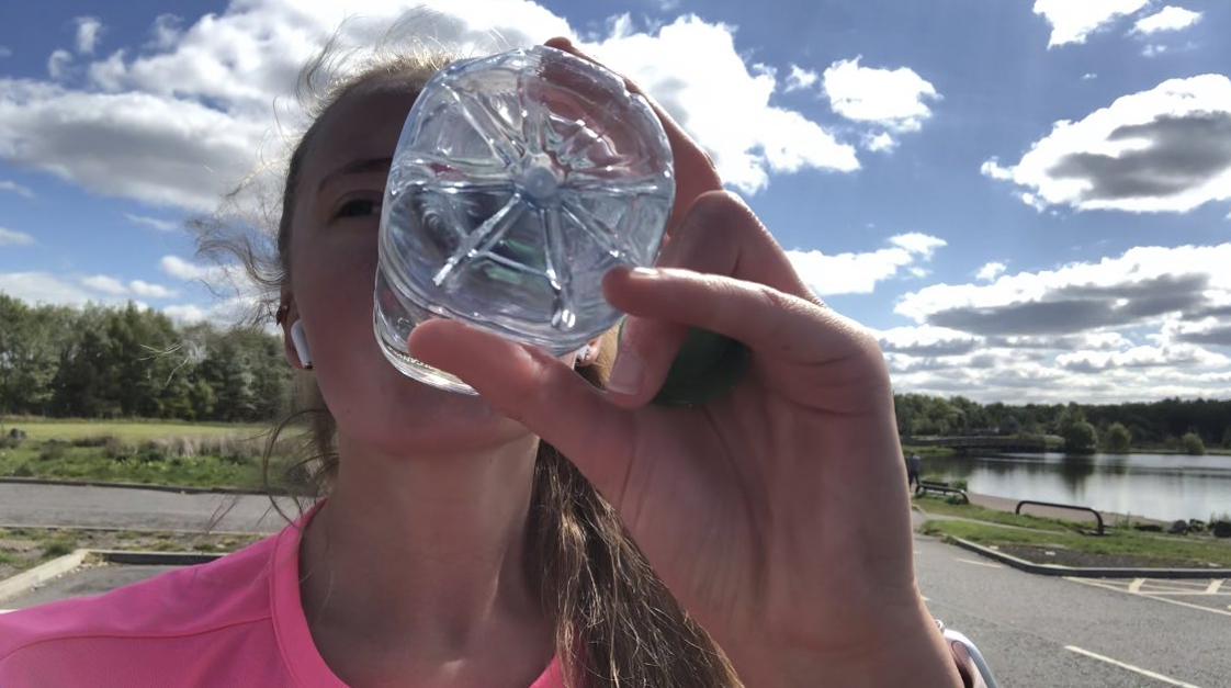 Teen drinking water while running a spontaneous marathon