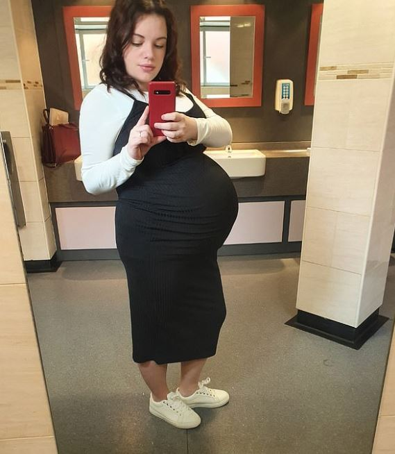 Mum showing off baby bump with triplets