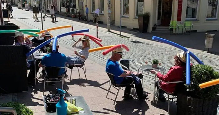 Café In Germany Celebrates Opening With Swimming Noodle Hats To Help Customers Social Distance