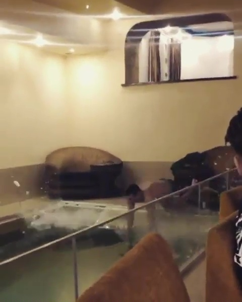 Guy Smashes Through Glass Swimming Pool Panel As Birthday Stunt Goes Wrong