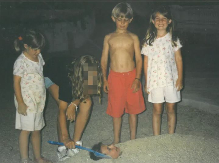 Heidi's sisters burying Ed's sister in the sand on holiday