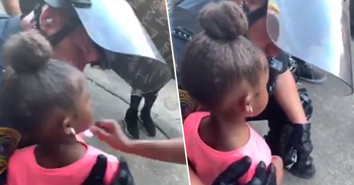 Police Officer Comforts Crying Girl Who Asked Him If He Was 'Going To Shoot Her'