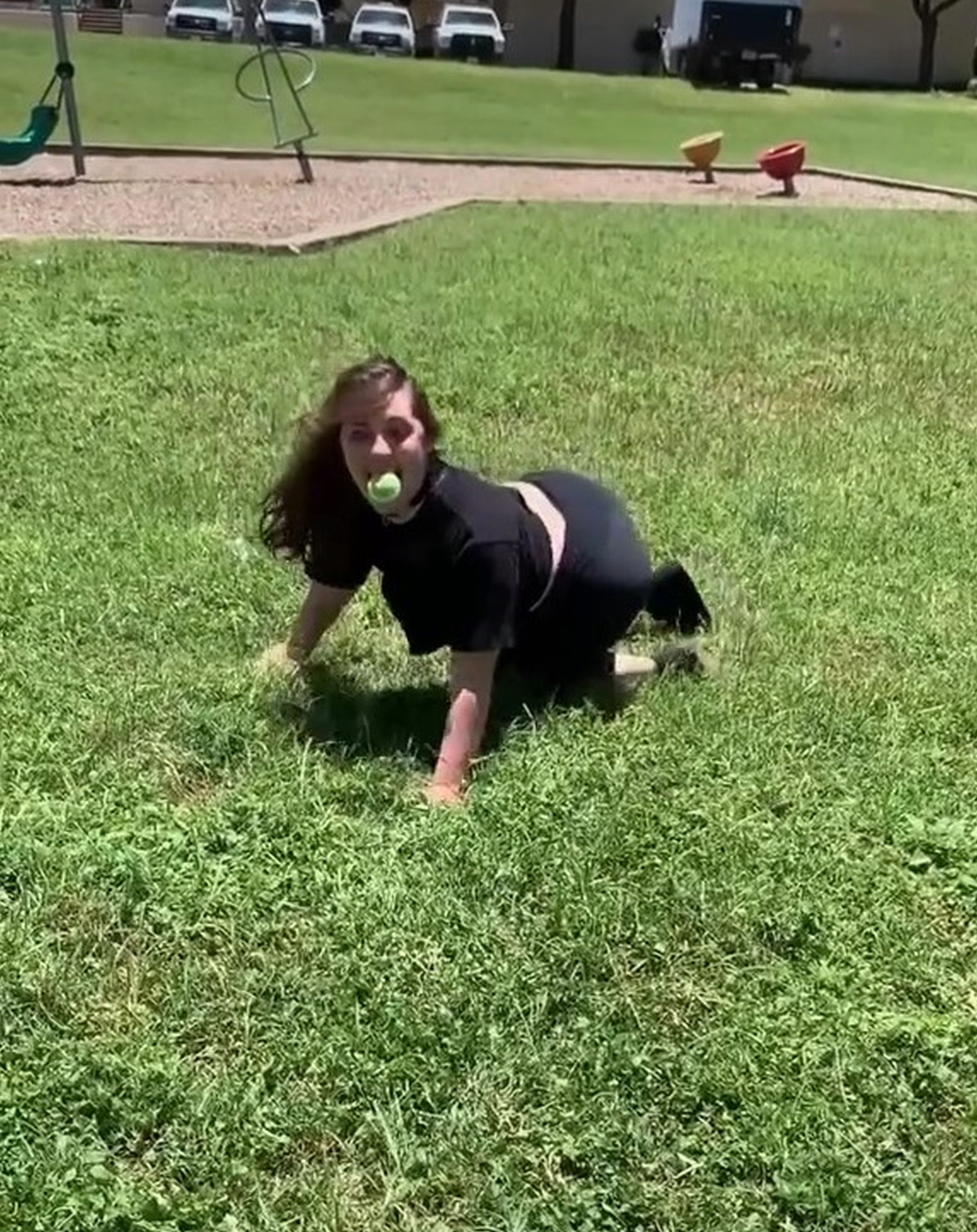 Woman who feels like a dog playing with ball