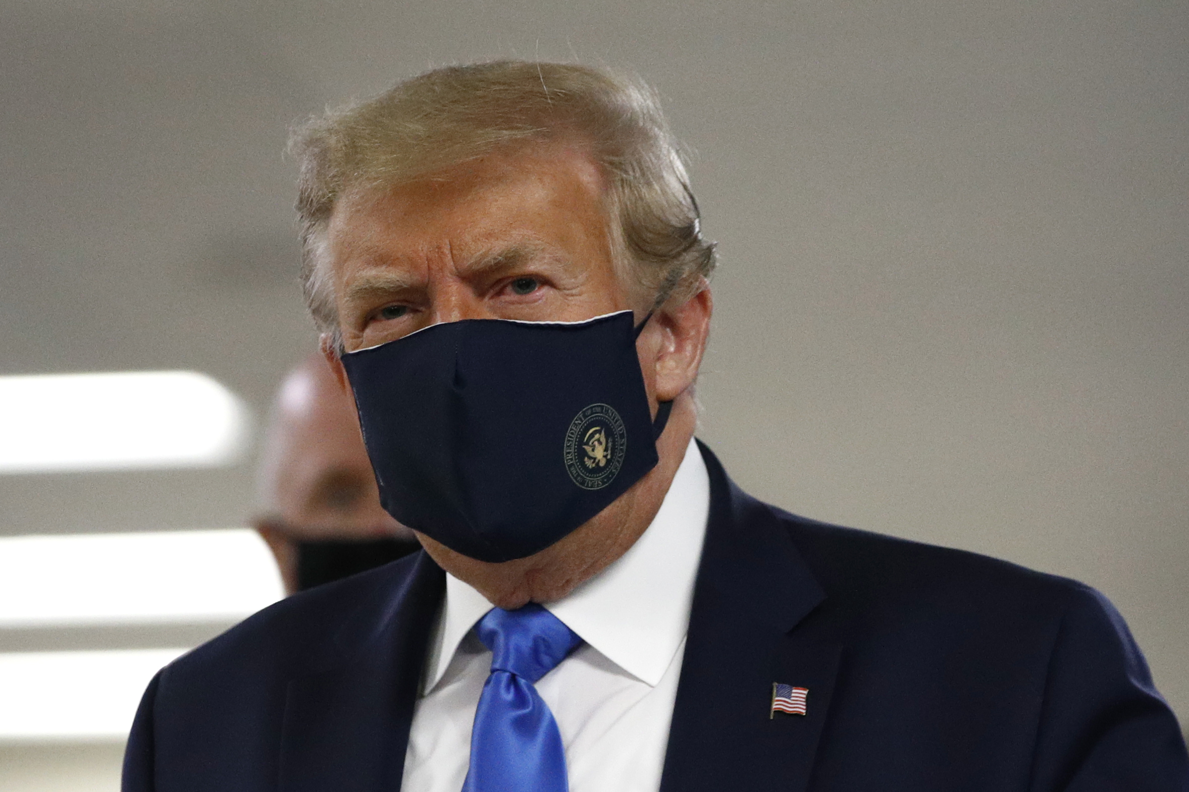 Donald Trump wears a mask for the first time