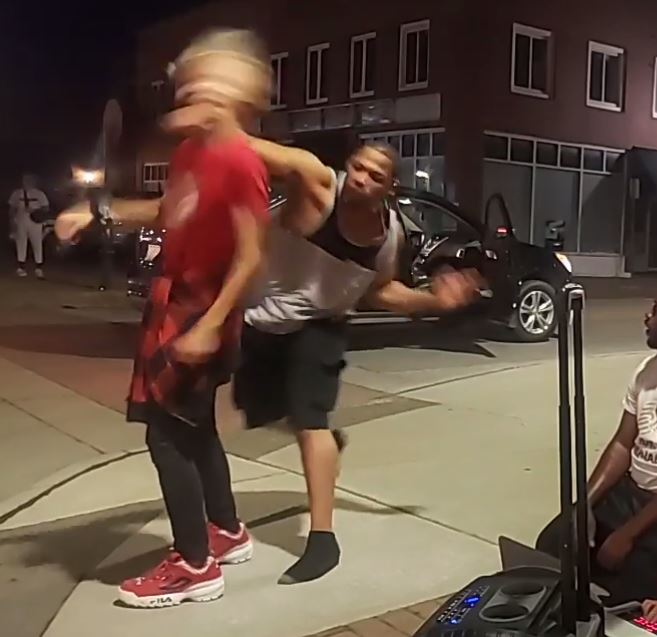 Man punches dancer performing on street