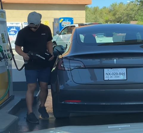 Tesla driver confused trying to put petrol pump in Tesla