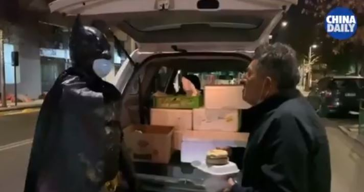 batman delivers food to homeless