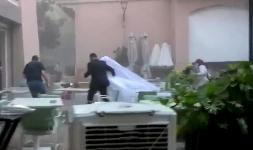 Beirut couple running inside after explosion
