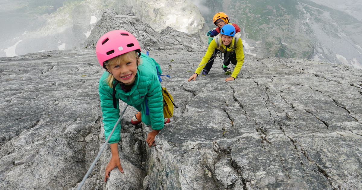 family climb mountain with 2 children 1