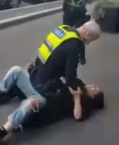 Police officer choking woman without mask