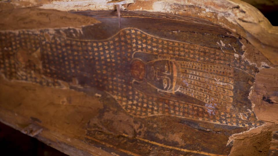 Painting visible on wooden coffins