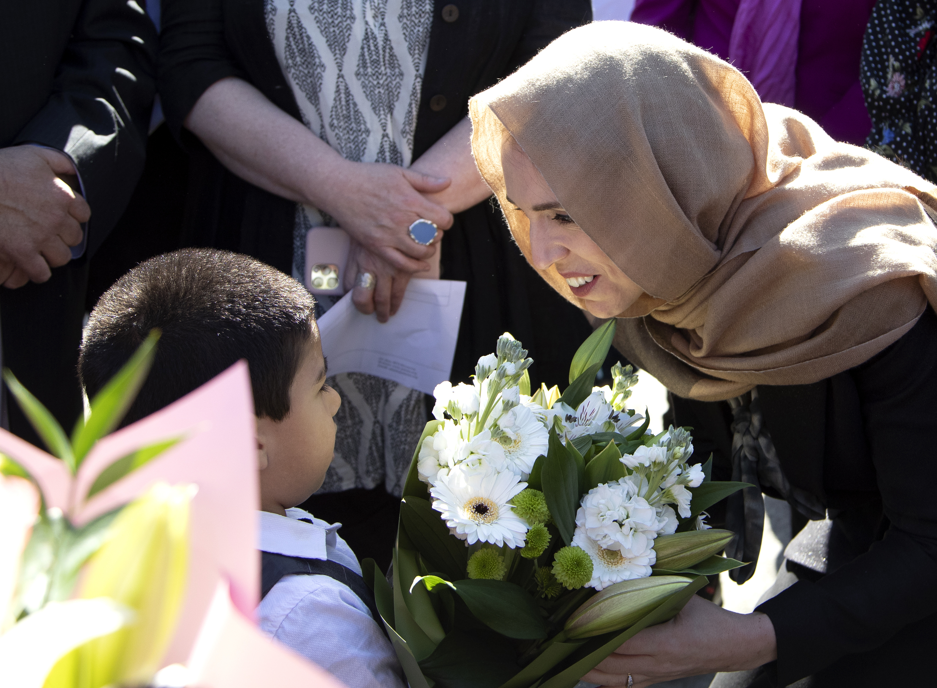 New Zealand Prime Minister Jacinda Ardern unveils a plaque at Christchurch mosque