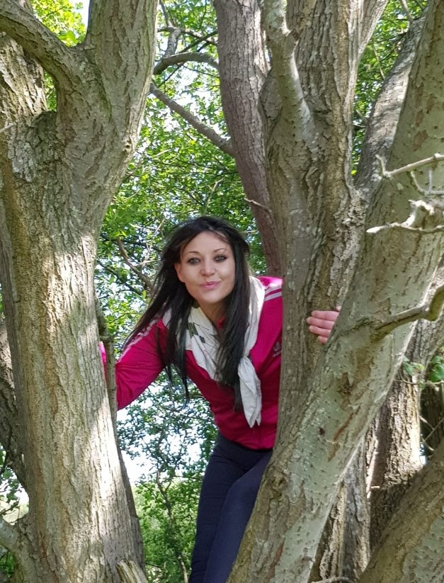 Kate in the branches of her husband tree