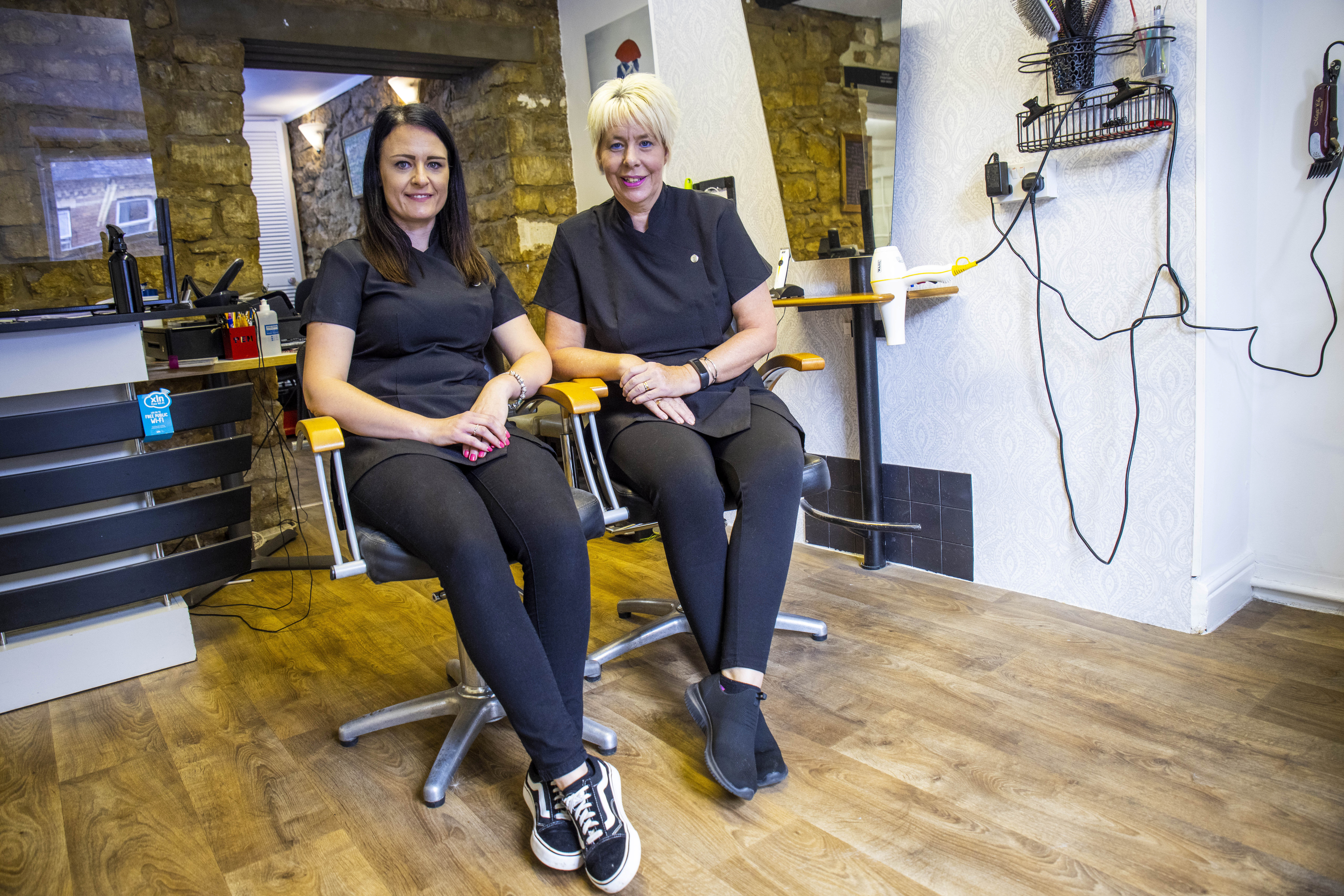 Alison Birch (R) owner of AJ's Unisex Salon alongside Claire Young, the manager