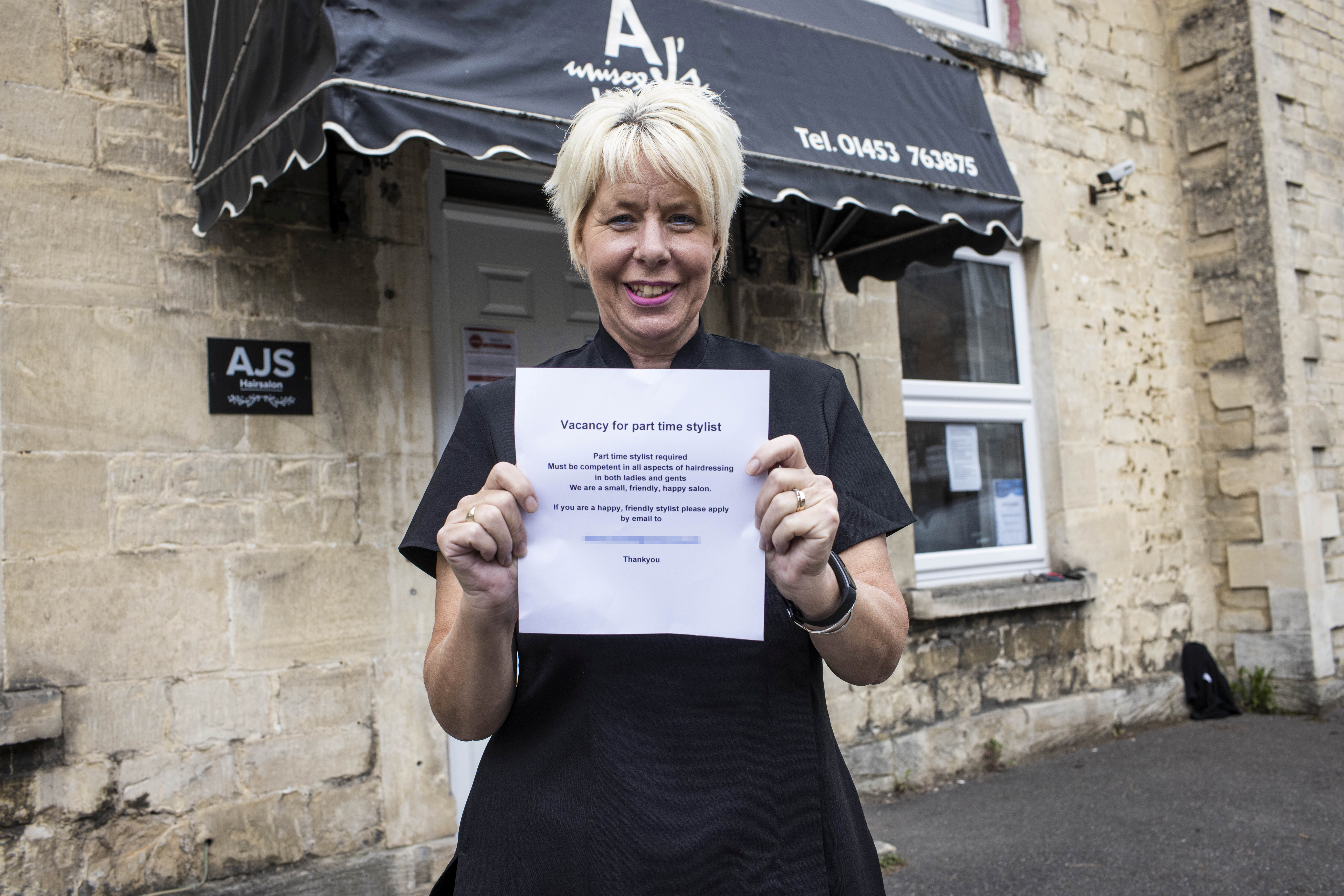 Alison Birch owner of AJ's Unisex Hairsalon holds a mock job advertisement worded very similarly to that which she posted online through the Job Centre.