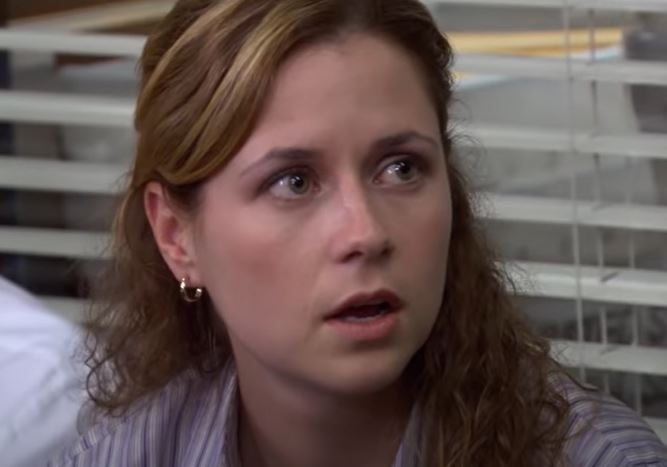 Pam reacts to Michael kissing Oscar in The Office