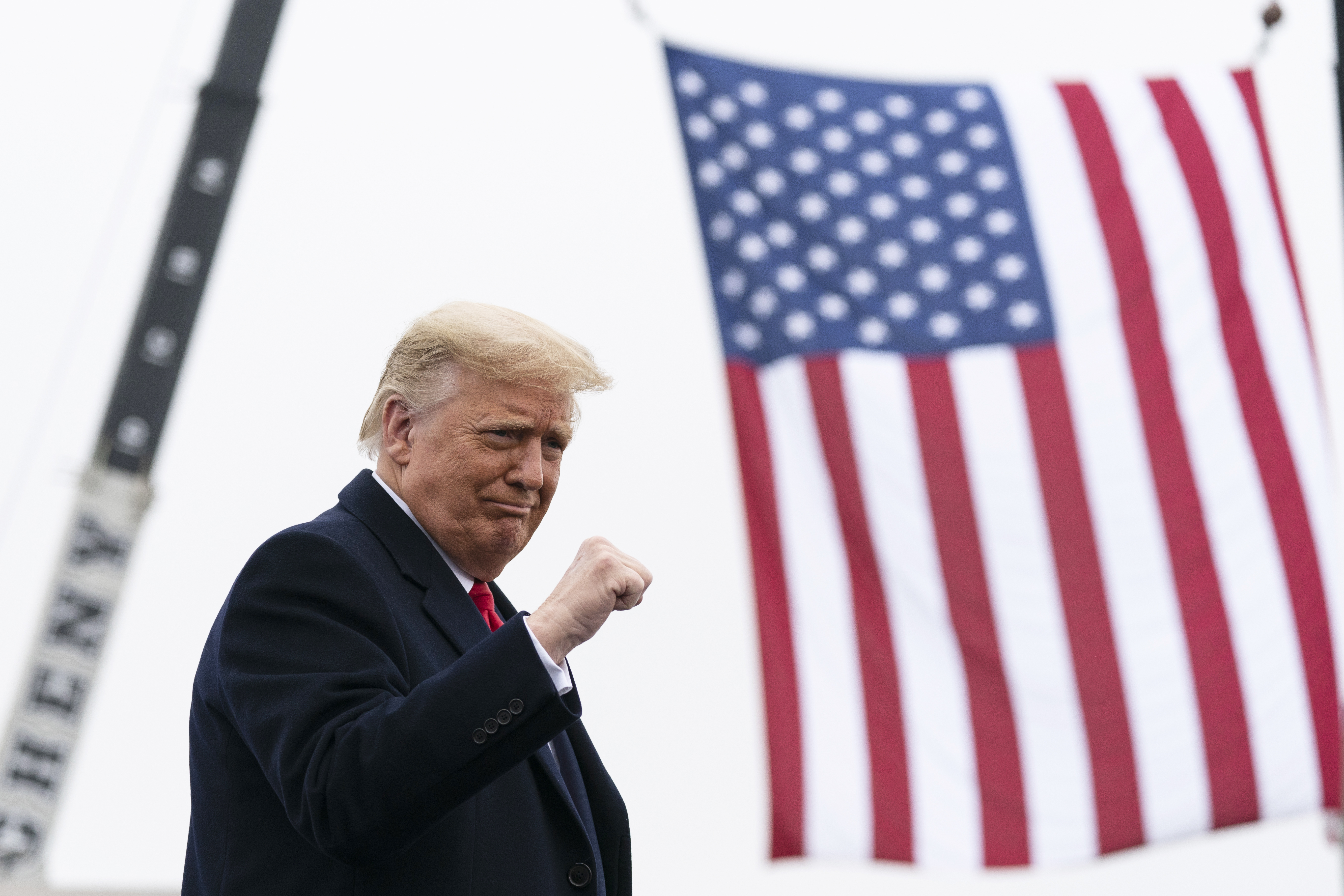 Donald Trump next to American flag (PA Images)